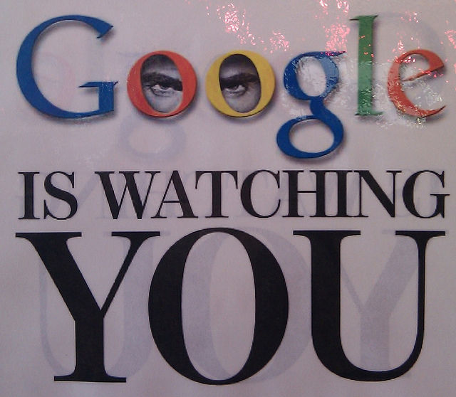 "A photograph of a poster (said to be from one of the Google cafeterias) reading ""GOOGLE IS WATCHING YOU"" with ""Google"" being the Google logo. The logo also has two eyes in the Os."